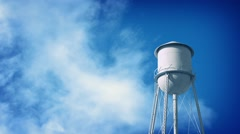 Water Tower With Clouds Passing Stock Footage