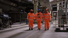 4K Cheerful team of engineers in power station chatting at the end of a shift Stock Footage