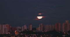 Super Moon - Real Scene Big Moon Rising Behind The Buildings - stock footage