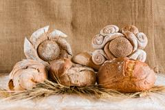 Bread and sheaves of wheat - stock photo