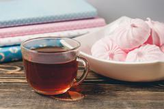 Fresh Pink Zephyr Marshmallow Cup of Tea Sweet Dessert Concept - stock photo