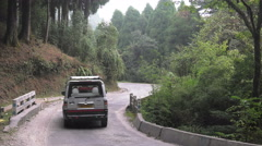 A local car driving on a rural road in Darjeeling district, West Bengal, India. Stock Footage