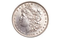 Antique silver dollar isolated Stock Photos