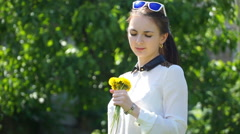 Footage woman with dandelion in the park Stock Footage