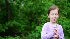 footage girl with dandelion in the park - stock footage
