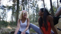4K Happy hipster friends camping in the woods, laughing & having fun - stock footage