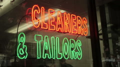 Cleaners & Tailors Neon Sign on Storefront Stock Footage