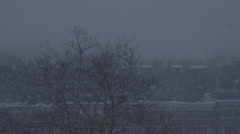 Snow Blizzard in a City Setting - Version  2 - No Color Correct - stock footage