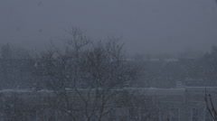 Snow Blizzard in a City Setting - Version 3 - No Color Correct Stock Footage