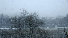 Snow Blizzard in a City Setting - Version 3 - Color Corrected Stock Footage