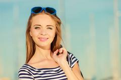 Girl enjoying summer breeze outdoor in marina Stock Photos