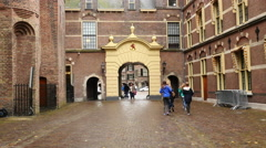 Time Lapse of People Walking Though Gate -  The Hague Netherlands - stock footage