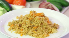 Fragrant pilaf with meat and vegetables Stock Footage