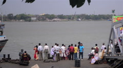 Over river Ganges in  Kolkata, jetty and vessel entering,people ready to travel. - stock footage