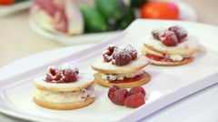 Freshly baked cookies with cream and raspberries Stock Footage