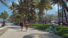 Tourists on Ocean Drive Miami Beach Stock Footage