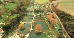 English Countryside Pond and Farm Aerial Video Stock Footage