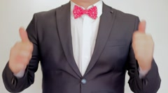 Businessman showing thumbs up - closeup shot. Success - stock footage