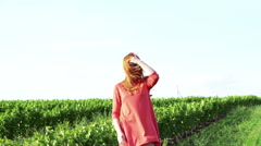 Cute girl posing in the green wheat field. Slowly Stock Footage
