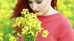 Close up of pretty girl smelling rape bouquet. Slow motion Stock Footage