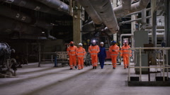 4K Team of engineers walking through power station & having a discussion Stock Footage