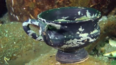 The ancient Greek drinking cup - kylix on the seabed (Black-glazed ware). - stock footage