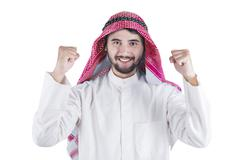 Happy Arabic man expressing his success - stock photo