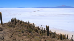 View of dormant volcano with the world largest Salt Flat in Uyuni Bolivia Stock Footage