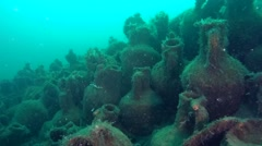 A large number of amphorae on the sea floor . Stock Footage