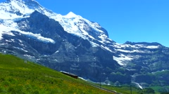 Train and mountainscape at Jungfraujoch, Switzerland - stock footage