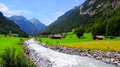 Clear water stream by the Alps, Switzerland, Europe Stock Footage