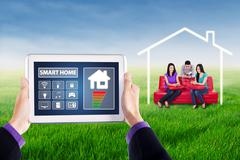 Smart house controller and young people - stock photo