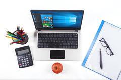 Stationery with laptop using windows 10 - stock photo