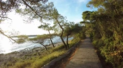 Time-lapse POV footage of a cycling lane by the sea, Croatia Stock Footage