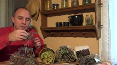 Man herbalist naturalist put dried thyme herb in glass jar. 4K Stock Footage