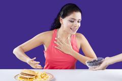 Woman Refuse to Eat Fast Food - stock photo