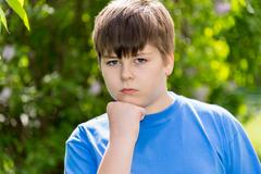 Portrait of boy of about 12 years in Park Stock Photos