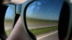 The road in reflection of woman's sunglasses, voyage, car trip - stock footage
