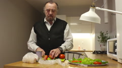 The man preparing salad in the kitchen Stock Footage