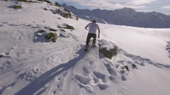 Man running in snow Aerial 2 Stock Footage