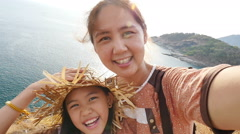 Asian mother and daughter taking selfie photograph together, Slow motion shot Stock Footage