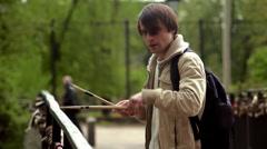 Man playing drum sticks on the bridge  Stock Footage
