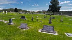 Aerial- low pass country cemetery Stock Footage