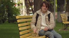 Man playing drum sticks on a bench in the city Stock Footage