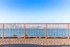 Red steel railing near sea with cityscape and skyline of san francisco Stock Photos