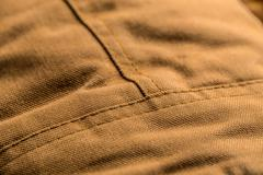 Stitch on brown coat - stock photo