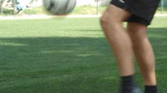 Man playing football kicking ball fills - stock footage