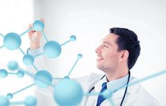 Young doctor with molecules Kuvituskuvat