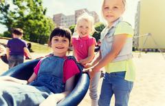 Happy kids on children playground Stock Photos