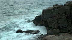 The waves hit the coastal cliff rising clouds of spray. Stock Footage